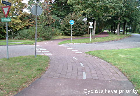 At many road junctions, cycle paths have priority